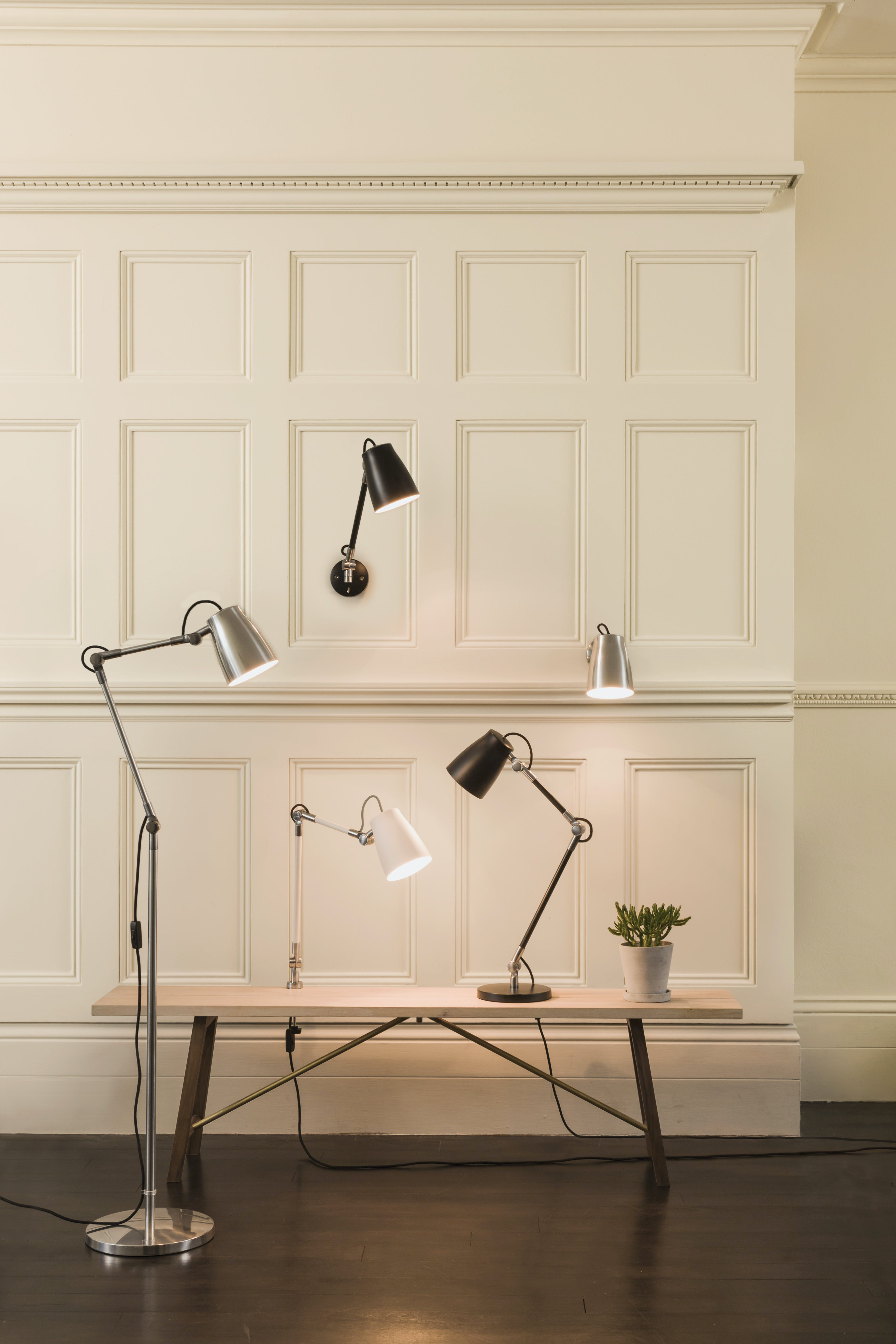 Five black and silver Astro lamps in bench