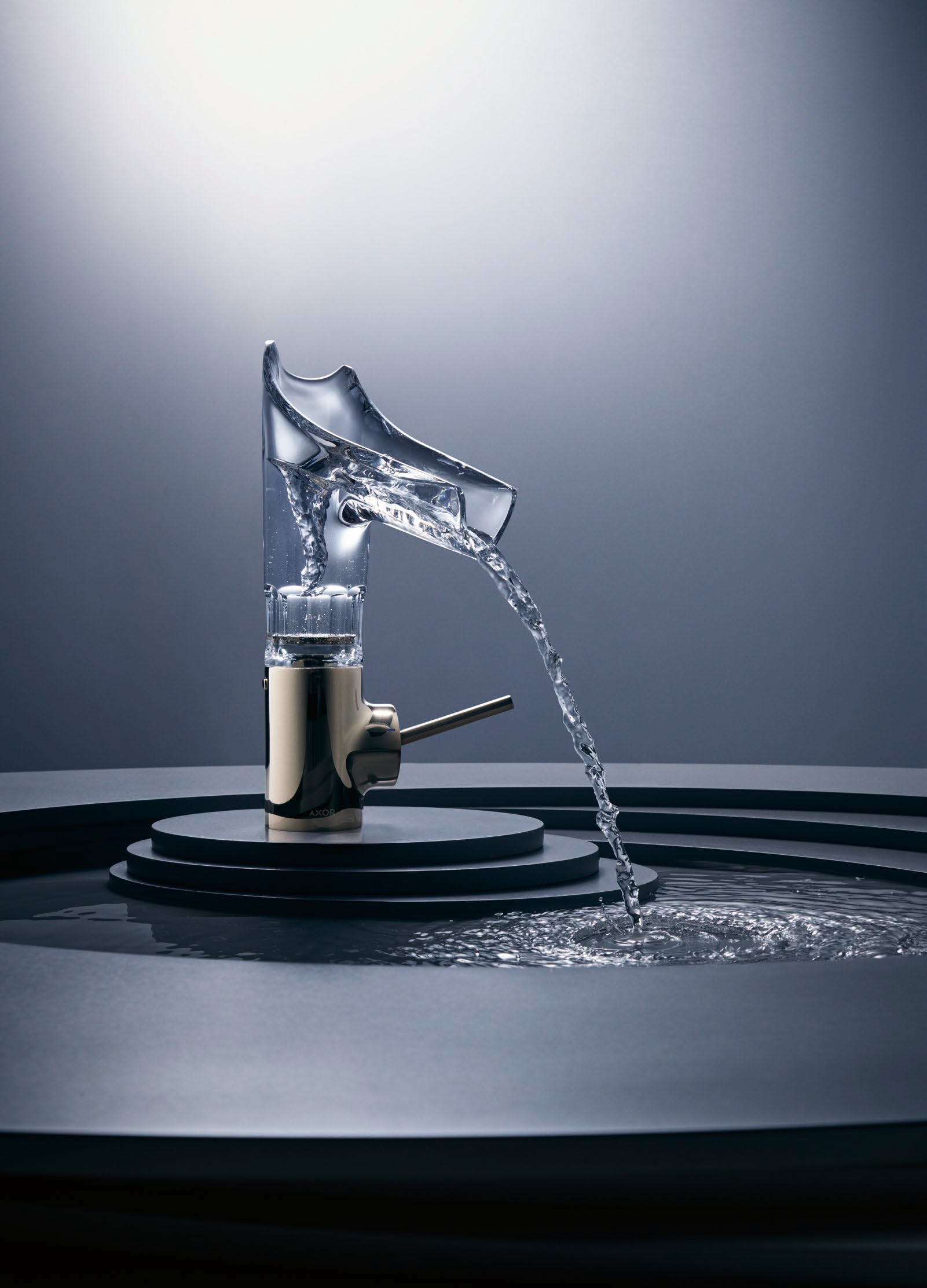 Gold AXOR tap with running water
