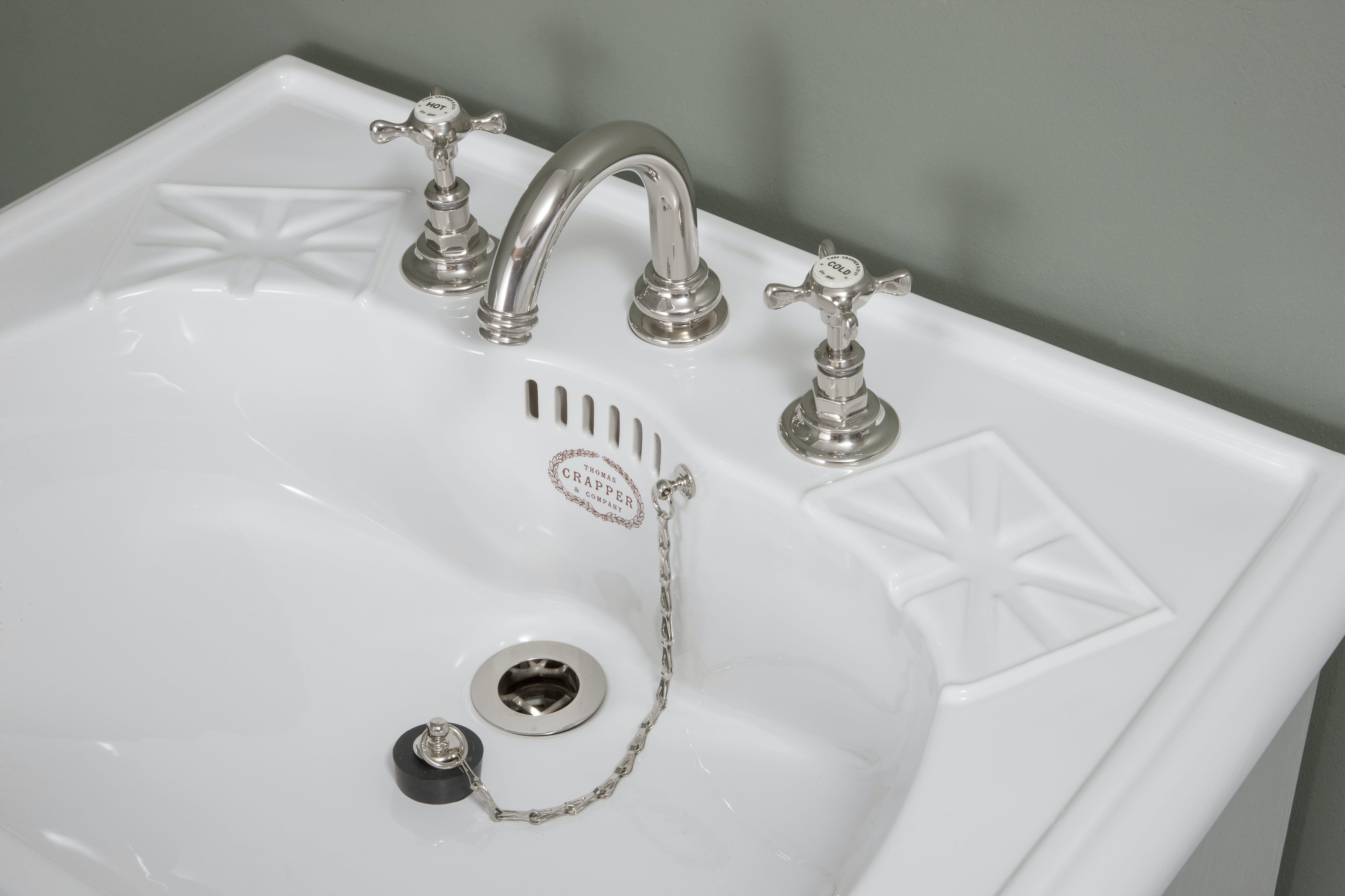 White Thomas Crapper Sink with Silver tap