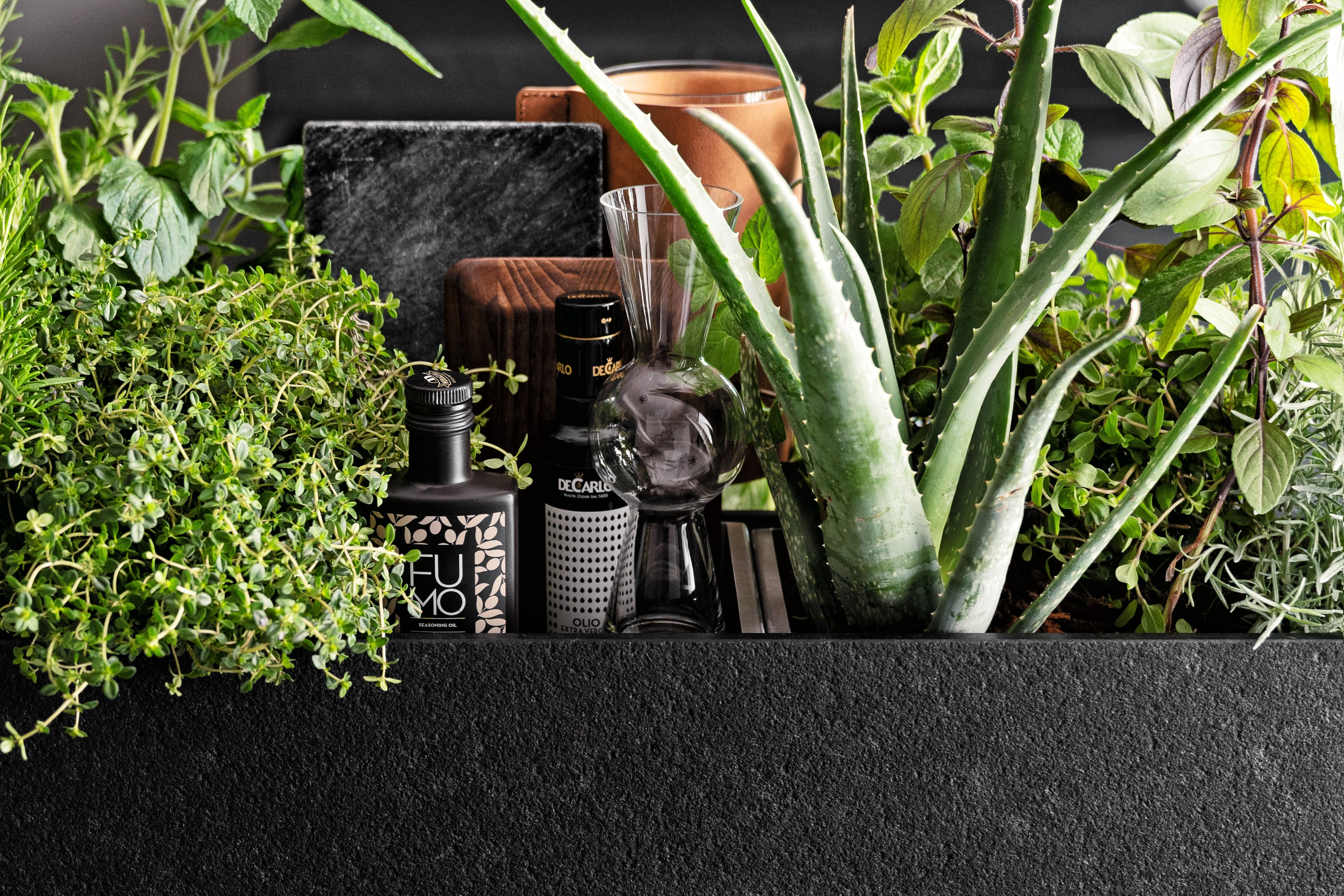 A herb garden in a SieMatic kitchen from Arcadia Home & Living