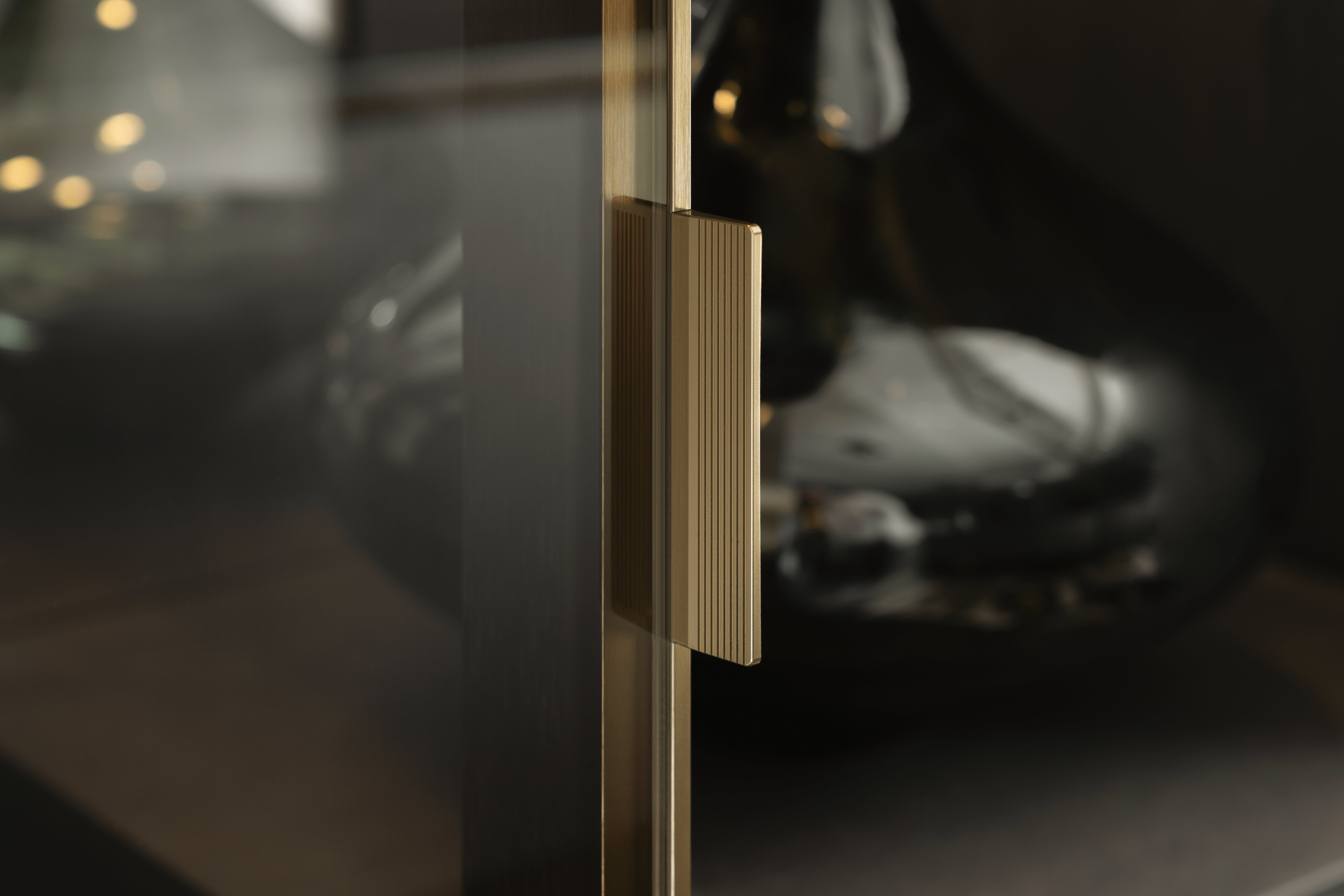 Close up image of gold SieMatic glass door handle